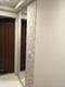 玄関にオーダーミラーとエコカラットプラスのペトラスクエア