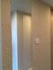 玄関にオーダーミラーとカッセのアイボリーベージュ