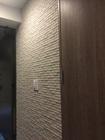 玄関にランド石ハツリ調のアイボリー